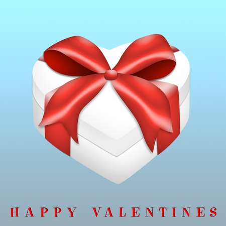 Heart-shaped valentines gift with red ribbon. photo