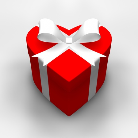 Heart-shaped gift with white ribbon.