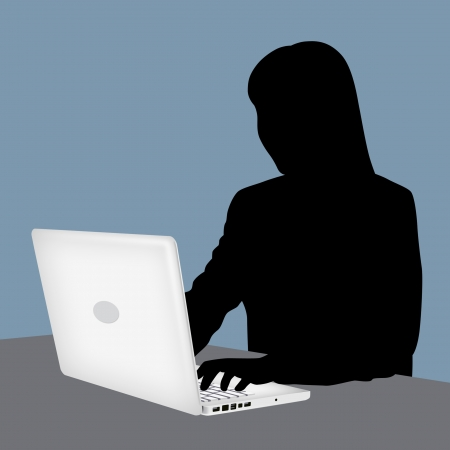 Silhouette of woman using laptop