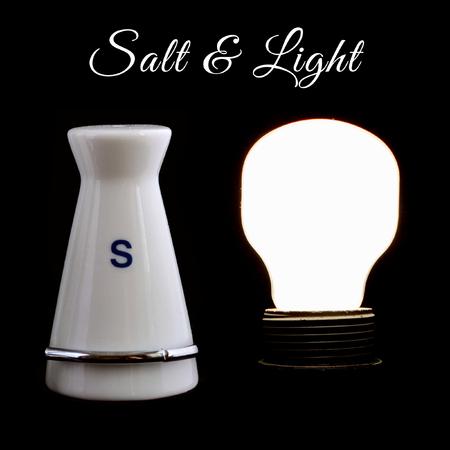 Salt and Light sign with salt shaker and lightbulb.