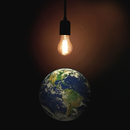 Light of the World sign with lightbulb and globe.