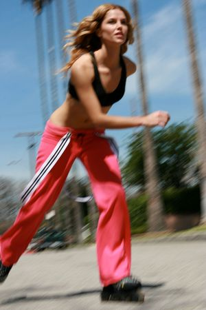 A Pretty girl rollerblading with motion blur photo