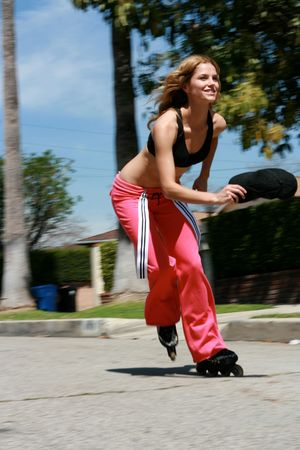 A Pretty girl rollerblading with motion blur