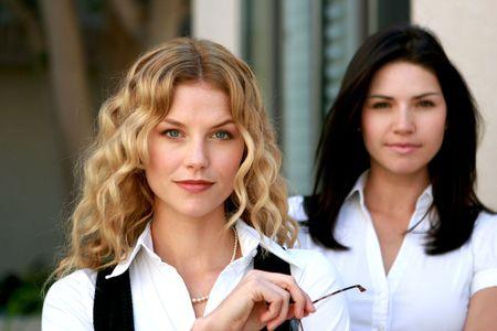Beautiful business women look at camera Stock Photo - 4716107