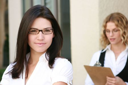 Beautiful business women looks at camera Stock Photo - 4716097