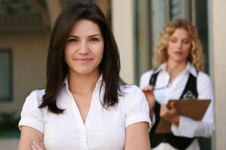 Beautiful business women looks at camera Stock Photo - 4716099