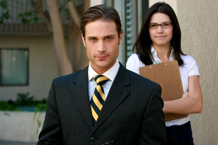 Attractive business team look toward camera Stock Photo - 4716098