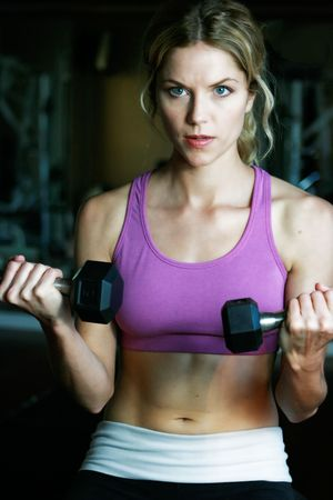 Attractive Blond exercising and lifting weights photo