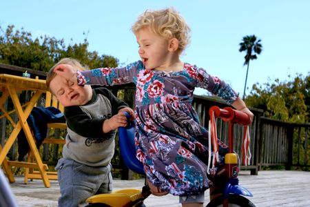 people fighting: Cute little boy and his sister playing a little rougher than usual Stock Photo