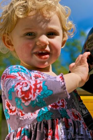 Cute and curious little girl in the sunshine Stock Photo - 4721776