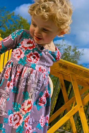 Cute and curious little girl in the sunshine Stock Photo - 4721814