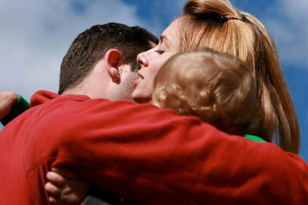Family hugs each other with a red shirt Stock Photo