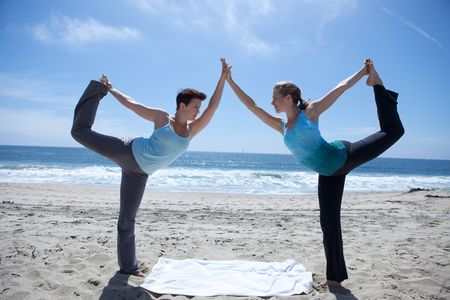 Woman Doing Yoga at the Beach Stock Photo - 4825369