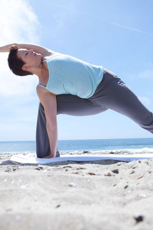 Woman Doing Yoga at the Beach Stock Photo - 4825371