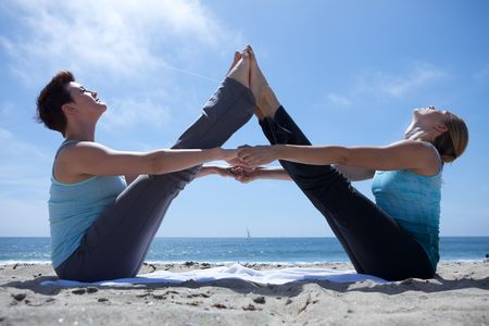 Woman Doing Yoga at the Beach Stock Photo - 4825372