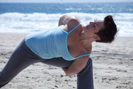 Woman Doing Yoga at the Beach Stock Photo - 4825370
