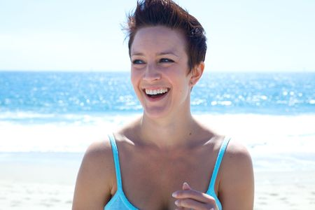 Beautiful Brunette smiles at the beach Stock Photo - 4963987
