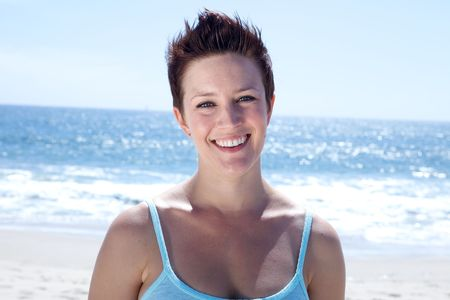 Beautiful Brunette smiles at the beach Stock Photo - 4963937
