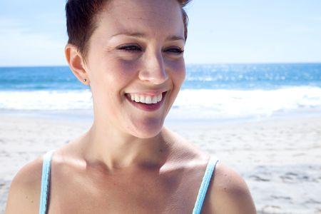 Beautiful Brunette looks at the beach Stock Photo - 4963943
