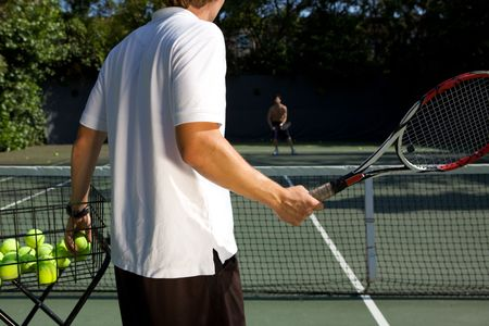 coach sport: Tennis Instructor Teaching His Student