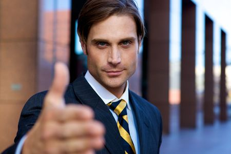 Attractive Businessman with hand outstretched