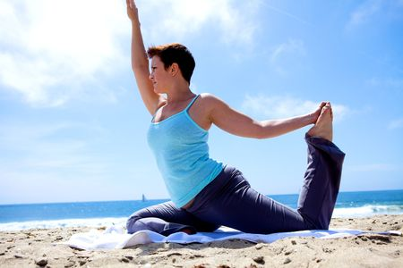 Yoga on the Beach Stock Photo - 5014136