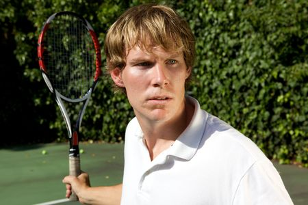 An upclose shot of a tennis player ready to hit a forhand backTennis Player photo