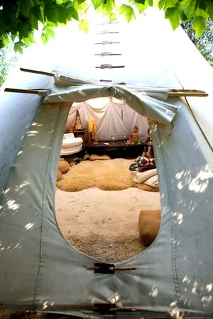 teepee: A teepee with an open flap to enter into it
