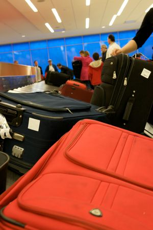 Bags moving around carousal at the airport  Stock Photo