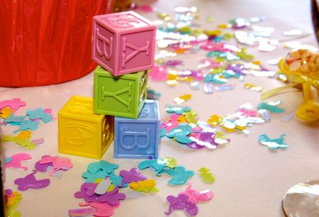 A photo of baby shower block and confetti