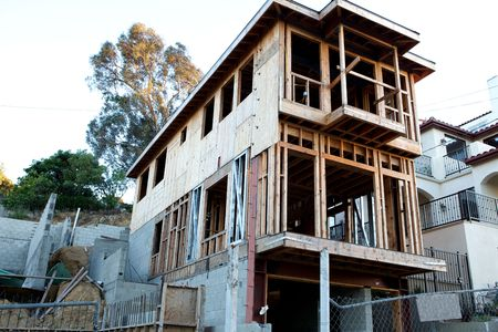 A house under construction from below with copy space Stock Photo - 5040123