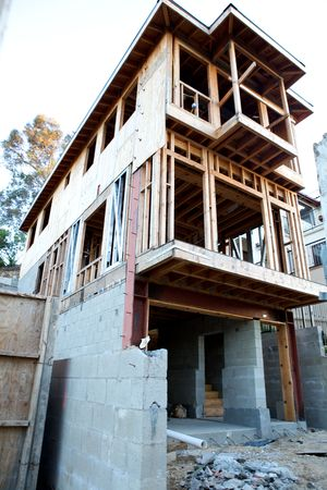 housebuilding: A house under construction from below with copy space