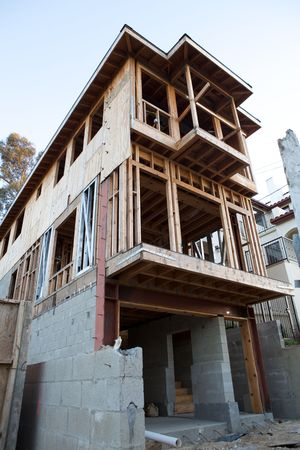 selected: A house under construction from below with copy space