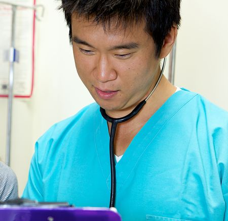 An Asian Doctor Working in a Hospital Stock Photo - 5058045