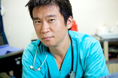 An Asian Doctor Working in a Hospital