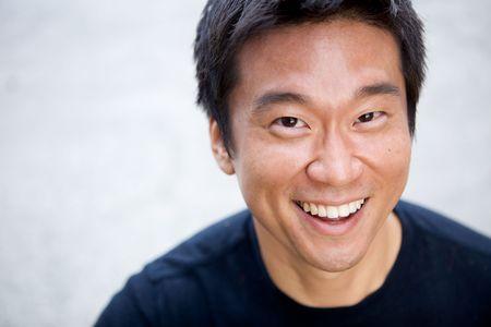 正直な顔をした興味深いアジア人の肖像画 写真素材