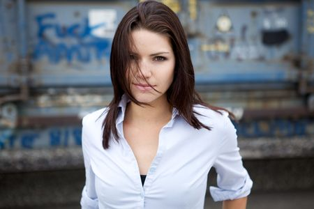 Beautiful Brunette with an edge and darker eye makeupA Beautiful Brunette in a collared shirt with an edge