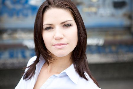 collared shirt: A Beautiful Brunette in a collared shirt with an edge