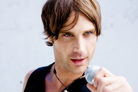 A Rock Star Jamming out with a microphone Stock Photo - 5095061