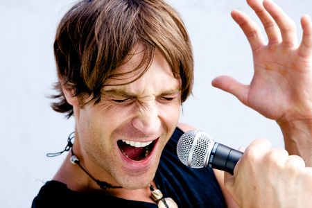 jamming: A Rock Star Jamming out with a microphone Stock Photo