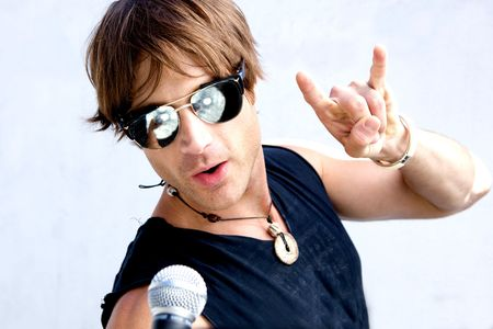 A Rock Star Jamming out with a microphone photo