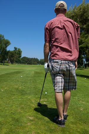 lining up: A golf player preparing to swing lining up shot Stock Photo