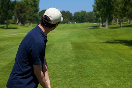 par: A golf player preparing to swing lining up shot Stock Photo
