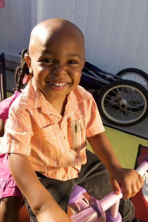 A Handsome little African American Boy smiling for the camera photo