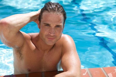 An Attractive Young man in the pool blue background photo