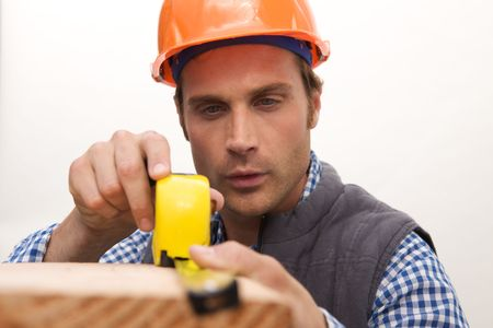 A Laborer working with measuring tape Stock Photo - 5280474