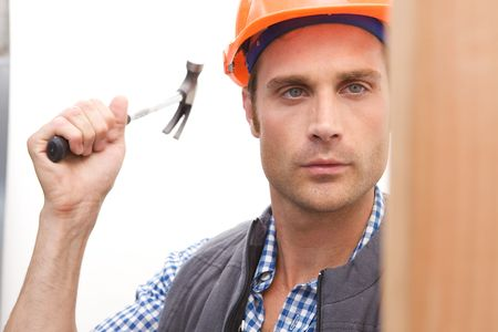A Construction Worker on the job with a hard hat photo