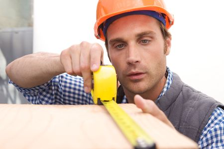 A Laborer working with measuring tape