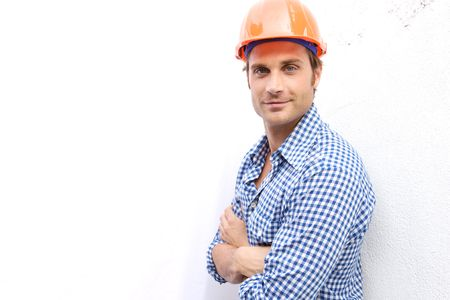 repairman: A Construction Worker on the job with a hard hat