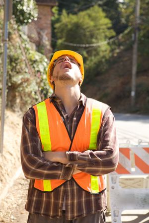 A Bored Construction Worker with his head back Stock Photo - 5280480